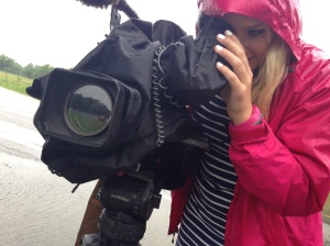 Shooting footage of flooding in the fields